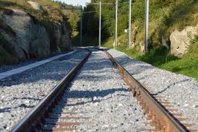 gray crushed stone on the railroad tracks