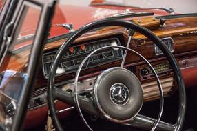 photo of the dashboard and steering wheel of a vintage Mercedes