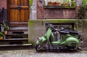 parked green scooter