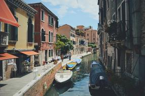 photo of a narrow canal in Venice, Italy