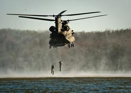 military jump from a helicopter into the water
