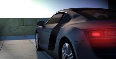 Back view of the black Audi R8 car with red lights