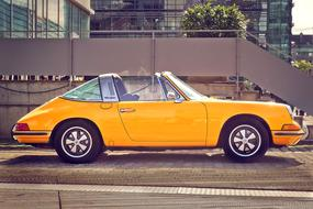 yellow retro porsche 911 convertible car