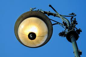 Colorful street eye lamp at blue sky background in Berlin, Germany