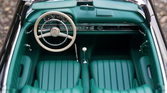 top view of green leather interior of retro mercedes car