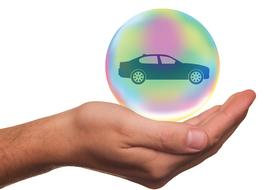 car in a bubble on hand