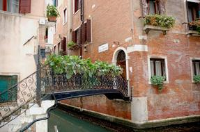 porch of a house across a canal in Venice, Italy
