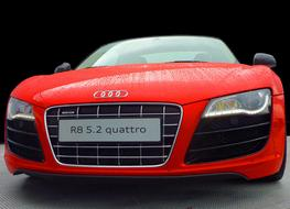 Front view of the red Audi Quattro sports cat in water drops