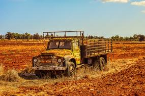 old rusty truck on a rural field