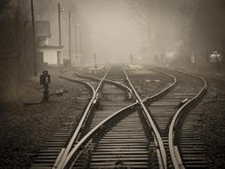 railroad switch on station in mist
