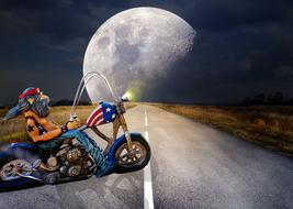 Biker and big moon