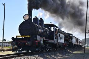 train with old steam locomotive in countryside, australia, ipswich