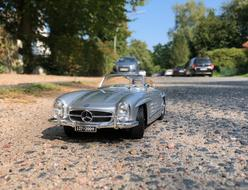 silver mercedes convertible on the pavement