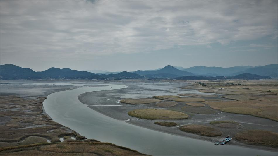 panoramic view of river at mountains, south korea, suncheon bay