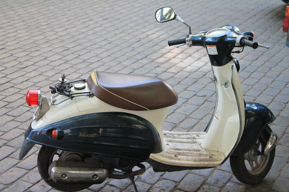 white moped transportation is parked on a street in Odessa