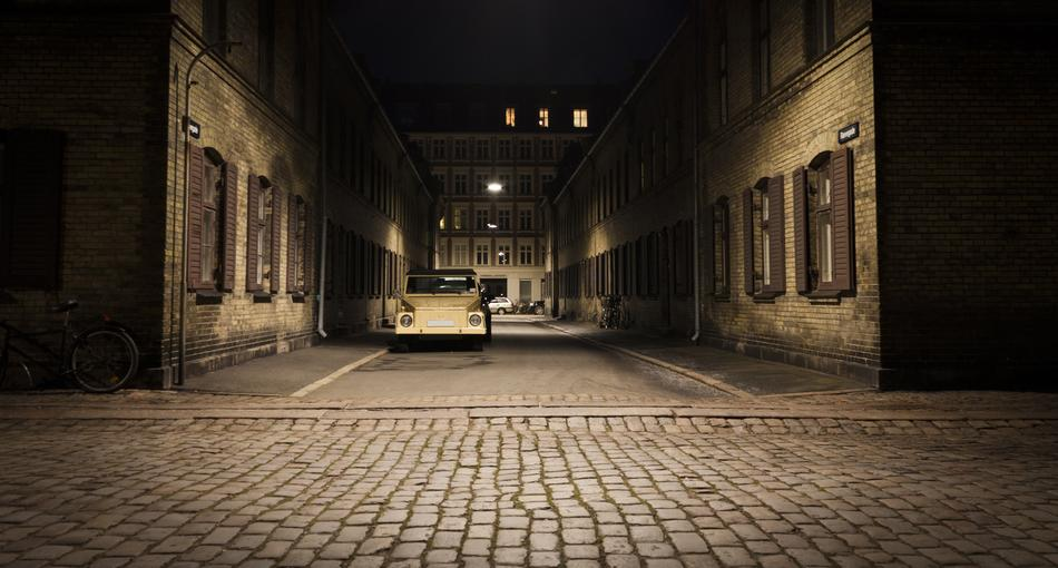 Beautiful street with the car in shadow and light in Copenhagen, Denmark