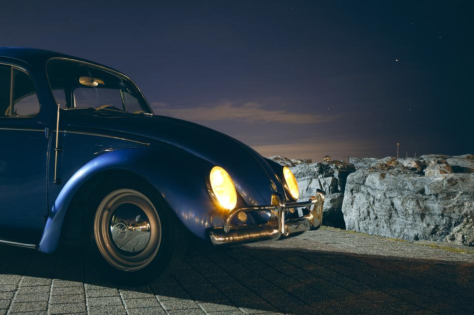 Beautiful, classic, retro, blue Volkswagen Beetle with bright headlights