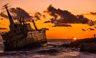 abandoned ship at sunset