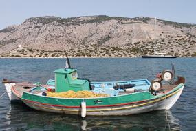 colorful Fishing Boat on water at coast, nobody, Greece