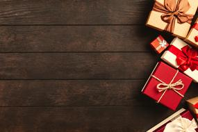 Gift Boxes on wooden table, Christmas background
