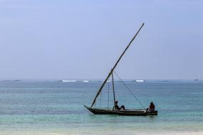 fisherman in a boat at sea on the shore of Diani Beach, Kenya