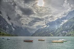 beautiful landscape of a boat on a mountain lake against a cloudy sky