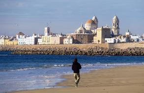 tourist is walking along the coast in Cadiz