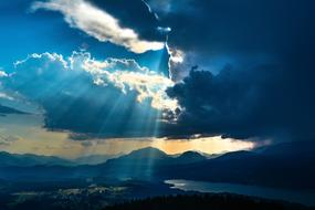 bright rays of the sun through storm clouds