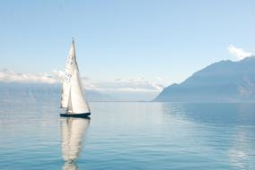 white sailing ship in a lake in Geneva