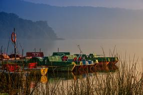 bright fishing boats at the pier on Lake Laach