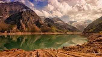 reflection of majestic mountains on the surface of an alpine lake