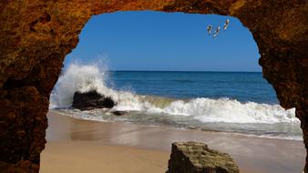 stone arch on the beach by the ocean