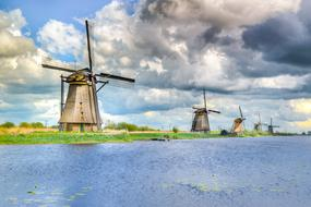 Beautiful and colorful landscape of Kinderdijk with windmills in Netherlands