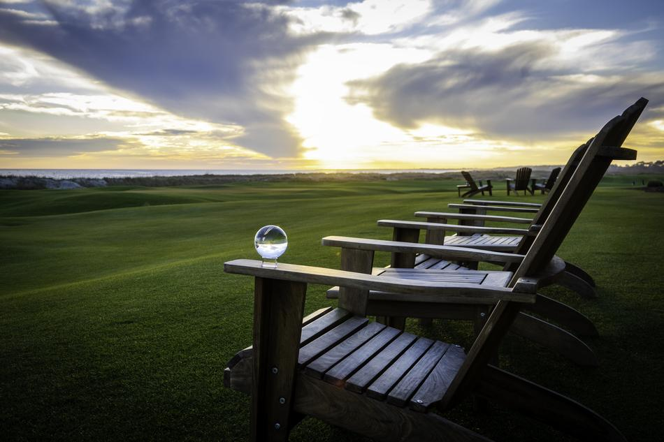 Crystal Ball on wooden chair in front of Golf Course at Sunset