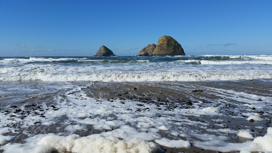 grey Rocks in blue sea near coast, usa, oregon, tillamook