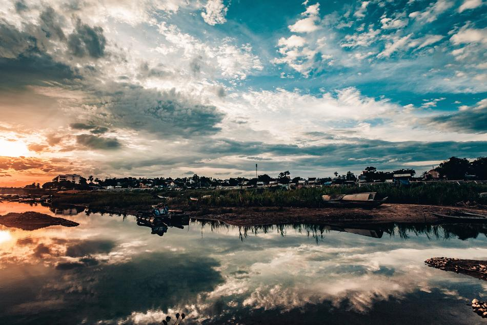 clouds are reflected in water in a picturesque landscape