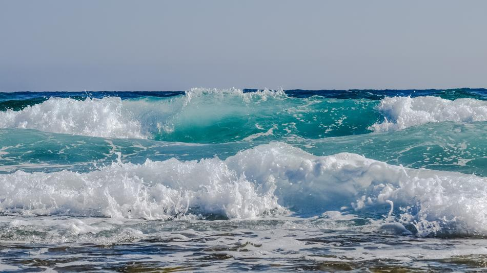 foamy spray of turquoise waves
