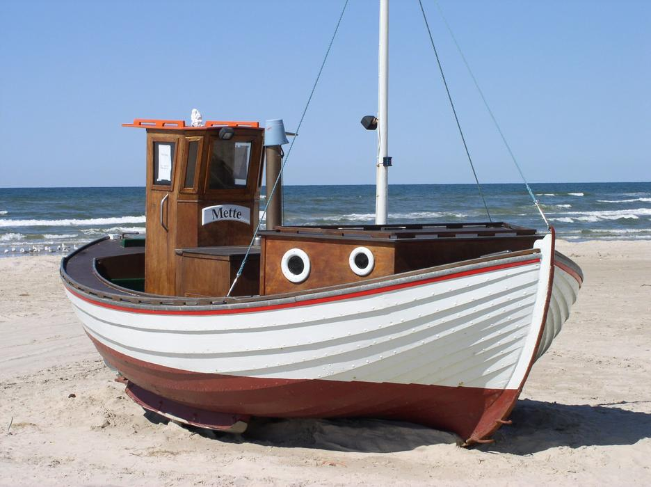 Fishing Boat on a sandy shore in denmark