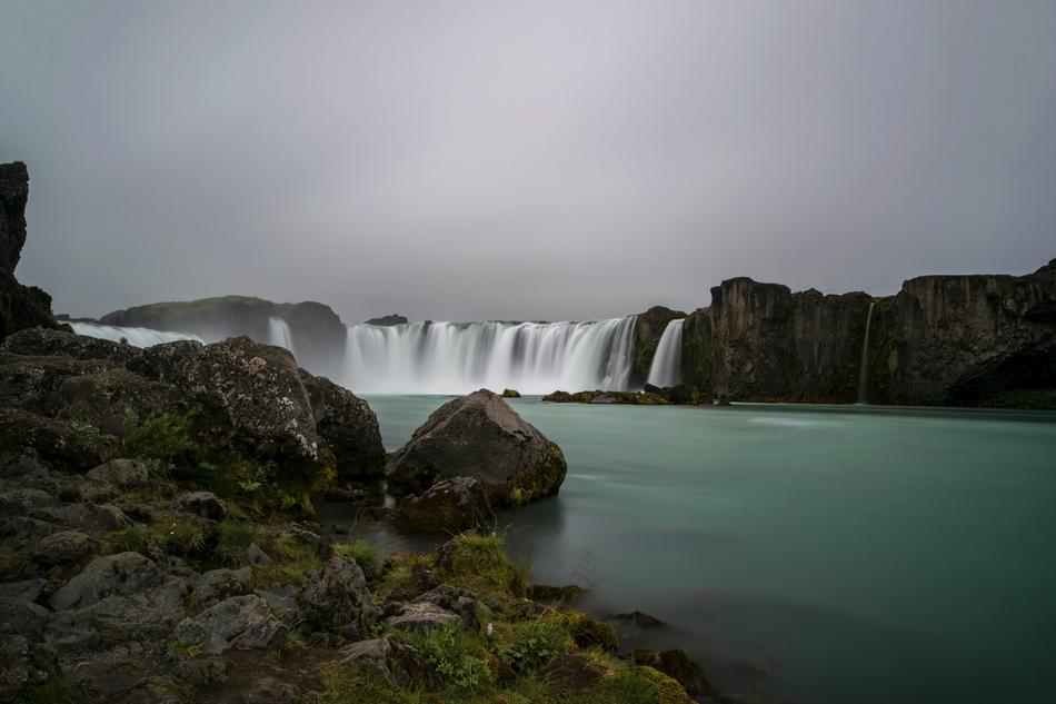 distant view of the Waterfall Godafoss in a picturesque landscape