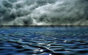 Storm clouds over water in a picturesque landscape