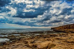 photo of a rocky coastline against a cloudy sky in Ayia Napa, Cyprus