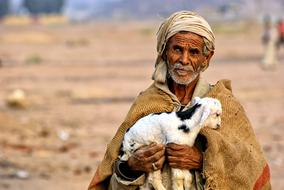 Egypt Man and small goat