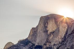 Cliff Half Dome and sun
