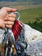 Climbing Ropes with carabiners in female hand