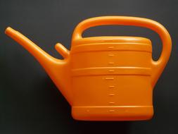 plastic orange watering can