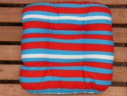 striped pillow on the garden bench