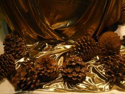 Pine Cones on golden tissue, Christmas Decoration