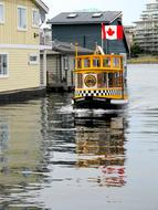 water taxi with the Canadian flag