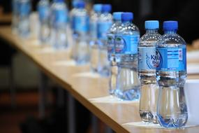 Water in plastic Bottles on table