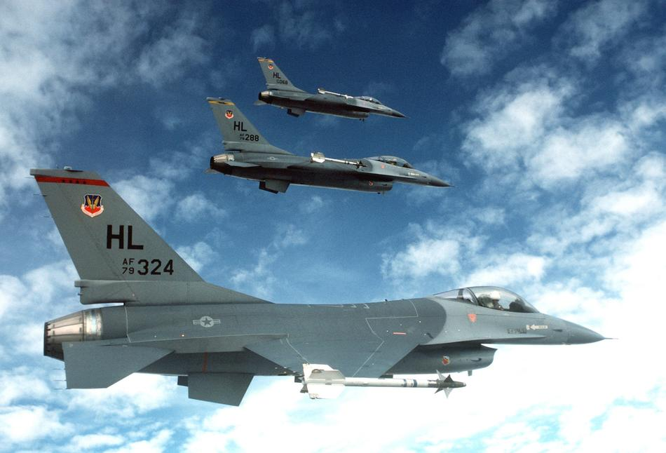three us army Fighter Jets in sky